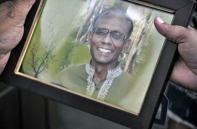 A man holds a portrait of Bangladeshi professor Rezaul Karim Siddique, who was hacked to death by unidentified attackers, in Rajshahi on April 23, 2016. Unidentified attackers hacked to death a university professor in Bangladesh on April 23, police said, adding that the assault bore the hallmarks of previous killings by Islamist militants of secular and atheist activists. Police said English professor Rezaul Karim Siddique, 58, was hacked from behind with machetes as he walked to the bus station from his home in the country's northwestern city of Rajshahi, where he taught at the city's public university. (Md. Abdullah Iqbal/AFP/Getty Images)
