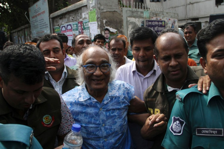 Bangladeshi security personnel escort Shafik Rehman (C) at a court following his arrest in Dhaka on April 16, 2016. Bangladesh police on April 16 arrested a magazine editor over a plot to kill the prime minister's son, officials said, the latest in a series of journalist detentions that has sparked fears of a press crackdown. (Stringer/AFP/Getty Images)