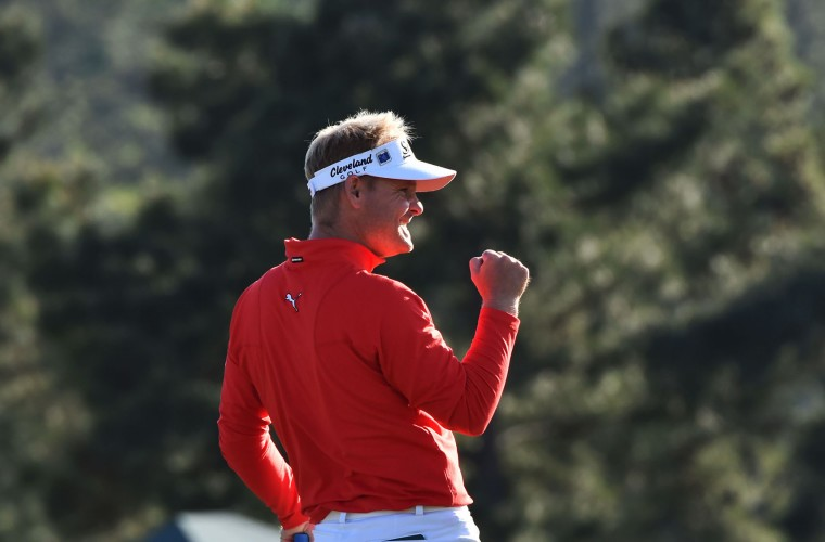 Denmark's Soren Kjeldsen reacts after finishing on the 18th green during Round 4 of the 80th Masters Golf Tournament at the Augusta National Golf Club on April 10, 2016, in Augusta, Georgia. England's Danny Willett won the 80th Masters at Augusta National on Sunday for his first major title. He was trailing defending champion Jordan Spieth by five strokes around the turn, but stormed down the back nine to overhaul the American. Willett is the first Englishman since Nick Faldo 20 years ago to win the Masters and only the second all-time. (Nicholas Kamm/AFP/Getty Images)