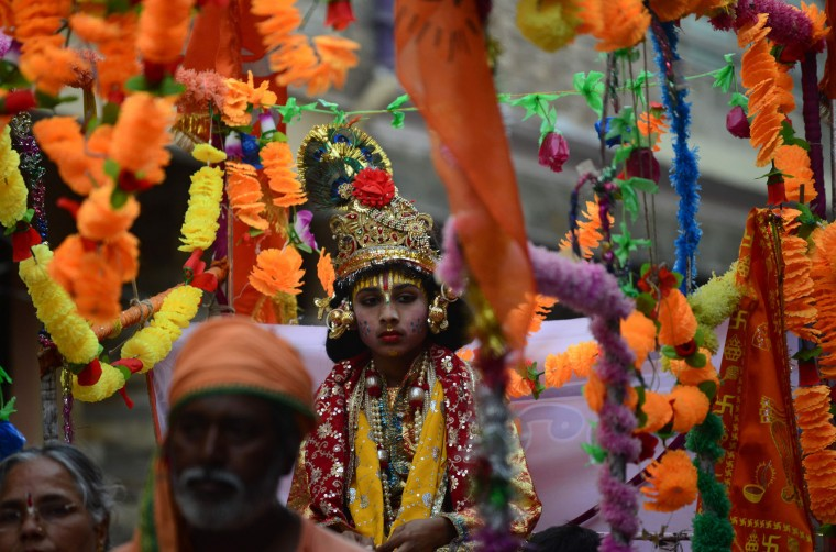 An Indian child dressed as Hindu Lord Rama participates in a procession to celebrate the Ram Navami festival in Allahabad on April 15, 2016. Hindu devotees celebrate the festival of Ram Navami, the birth anniversary of Lord Rama, across India, which also marks the end of the nine-day long fasting and Navaratri festival. (Sanjay Kanojia/AFP/Getty Images)