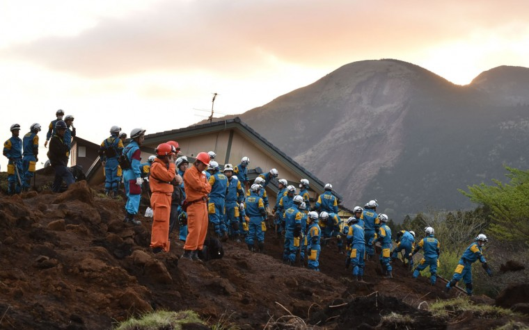 Japanese policemen search for survivors at a landslide site after earthquakes in Minami-Aso, Kumamoto prefecture, on April 17, 2016. At least 41 people are known to have died in the double disaster, with up to eight still missing -- feared buried in shattered houses or under torrents of mud. / AFP PHOTO / KAZUHIRO NOGIKAZUHIRO NOGI/AFP/Getty Images