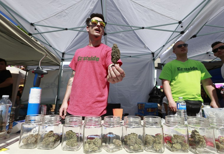 A vendor sells pot as thousands of people gather at 4/20 celebrations on April 20, 2016 at Sunset Beach in Vancouver, Canada. The Vancouver 4/20 event is the largest free protest festival in the city, with day-long music, public speakers and the world's only open-air public cannabis farmer's market where people sell all kinds of cannabis and extracts while educating the crowd about medical marijuana, political involvement and activism. Canadian Federal Health Minister Jane Philpott says Canada will roll out the legislation in the spring of 2017 to begin the process of legalizing and regulating marijuana. (Photo by Jeff Vinnick/Getty Images)
