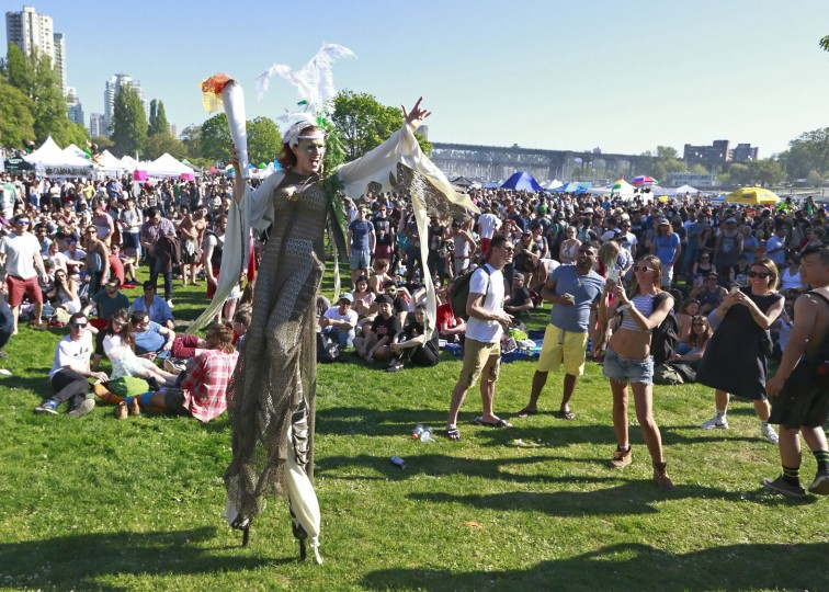 A woman walks on stilts through a large crowd as thousands of people gather at 4/20 celebrations on April 20, 2016 at Sunset Beach in Vancouver, Canada. The Vancouver 4/20 event is the largest free protest festival in the city, with day-long music, public speakers and the world's only open-air public cannabis farmer's market where people sell all kinds of cannabis and extracts while educating the crowd about medical marijuana, political involvement and activism. Canadian Federal Health Minister Jane Philpott says Canada will roll out the legislation in the spring of 2017 to begin the process of legalizing and regulating marijuana. (Photo by Jeff Vinnick/Getty Images)