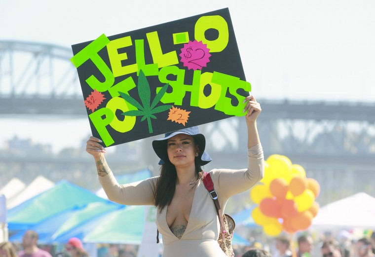 A vendor sells Jell-o pot shots as thousands of people gathered at 4/20 celebrations on April 20, 2016 at Sunset Beach in Vancouver, Canada. The Vancouver 4/20 event is the largest free protest festival in the city, with day-long music, public speakers and the world's only open-air public cannabis farmer's market where people sell all kinds of cannabis and extracts while educating the crowd about medical marijuana, political involvement and activism. Canadian Federal Health Minister Jane Philpott says Canada will roll out the legislation in the spring of 2017 to begin the process of legalizing and regulating marijuana. (Photo by Jeff Vinnick/Getty Images)