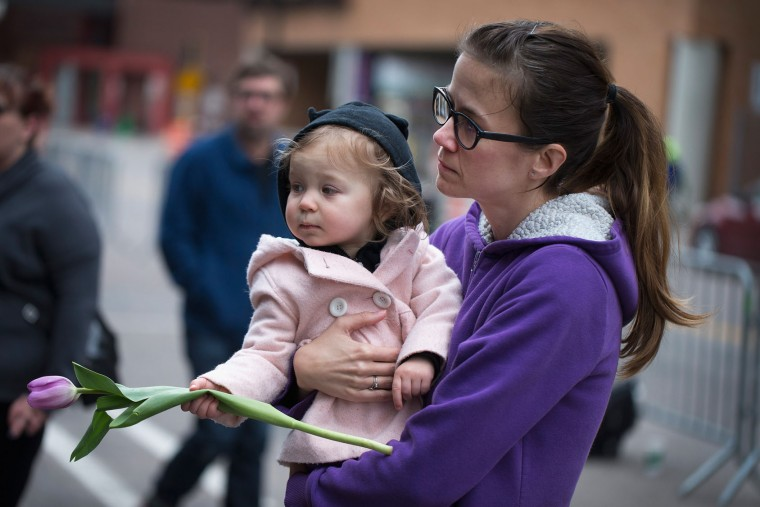 Melissa Hokuf and her daughter Hartley visit a memorial to Prince outside the First Avenue nightclub on April 22, 2016 in Minneapolis, Minnesota. Prince, 57, was pronounced dead shortly after being found unresponsive yesterday at his Paisley Park Studio in Chanhassen, Minnesota near Minneapolis. (Photo by Scott Olson/Getty Images)