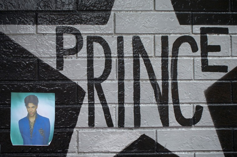 A photo of Prince is attached to the wall outside of the First Avenue nightclub where fans have created a memorial to the artist on April 22, 2016 in Minneapolis, Minnesota. Prince, 57, was pronounced dead shortly after being found unresponsive yesterday at his Paisley Park Studio in Chanhassen, Minnesota near Minneapolis. (Photo by Scott Olson/Getty Images)