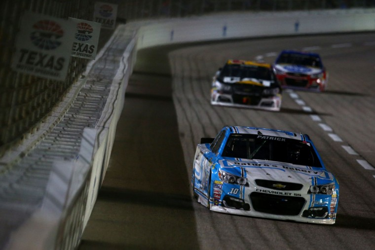 FORT WORTH, TEXAS - APRIL 09: Danica Patrick, driver of the #10 Nature's Bakery Chevrolet, leads a pack of cars during the NASCAR Sprint Cup Series Duck Commander 500 at Texas Motor Speedway on April 9, 2016 in Fort Worth, Texas. (Photo by Sarah Crabill/Getty Images for Texas Motor Speedway)