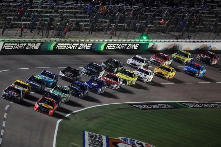 FORT WORTH, TEXAS - APRIL 09: Martin Truex Jr., driver of the #78 Bass Pro Shops/TRACKER Boats Toyota, leads the field in a restart during the NASCAR Sprint Cup Series Duck Commander 500 at Texas Motor Speedway on April 9, 2016 in Fort Worth, Texas. (Photo by Tom Pennington/Getty Images)