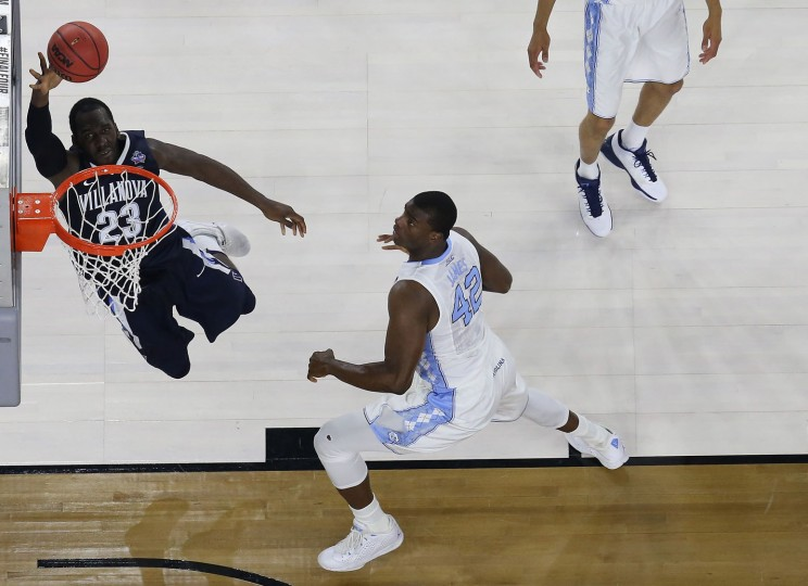 Daniel Ochefu #23 of the Villanova Wildcats lays the ball up against Joel James #42 of the North Carolina Tar Heels during the 2016 NCAA Men's Final Four National Championship game at NRG Stadium on April 4, 2016 in Houston, Texas. (Photo by Ronald Martinez/Getty Images)