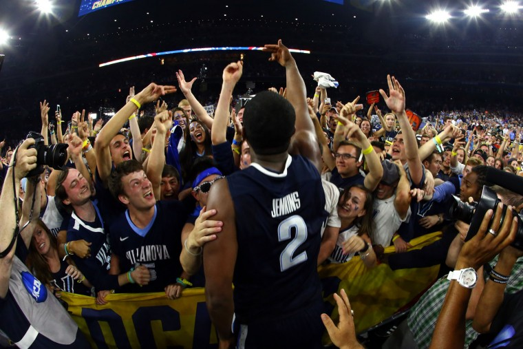 Kris Jenkins #2 of the Villanova Wildcats celebrates with fans after making the game-winning three pointer to defeat the North Carolina Tar Heels 77-74 in the 2016 NCAA Men's Final Four National Championship game at NRG Stadium on April 4, 2016 in Houston, Texas. (Photo by Ronald Martinez/Getty Images)