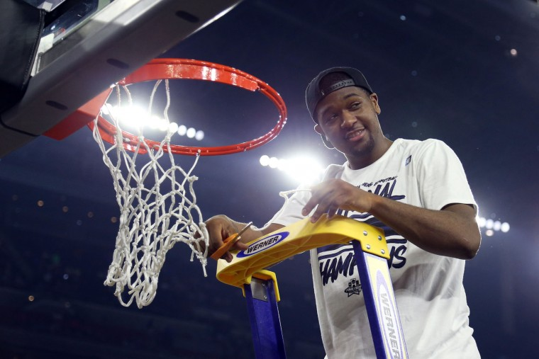 Kris Jenkins #2 of the Villanova Wildcats cuts the net after defeating the North Carolina Tar Heels 77-74 to win the 2016 NCAA Men's Final Four National Championship game at NRG Stadium on April 4, 2016 in Houston, Texas. (Photo by Streeter Lecka/Getty Images)