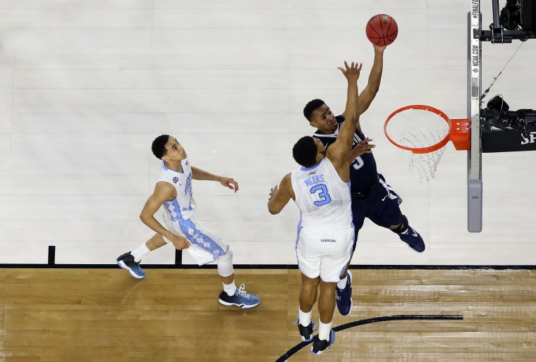 Phil Booth #5 of the Villanova Wildcats shoots the ball over Kennedy Meeks #3 of the North Carolina Tar Heels during the 2016 NCAA Men's Final Four National Championship game at NRG Stadium on April 4, 2016 in Houston, Texas. (Photo by Streeter Lecka/Getty Images)