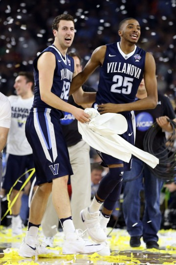 Kevin Rafferty #52 of the Villanova Wildcats and Mikal Bridges #25 celebrate defeating the North Carolina Tar Heels 77-74 to win the 2016 NCAA Men's Final Four National Championship game at NRG Stadium on April 4, 2016 in Houston, Texas. (Photo by Streeter Lecka/Getty Images)
