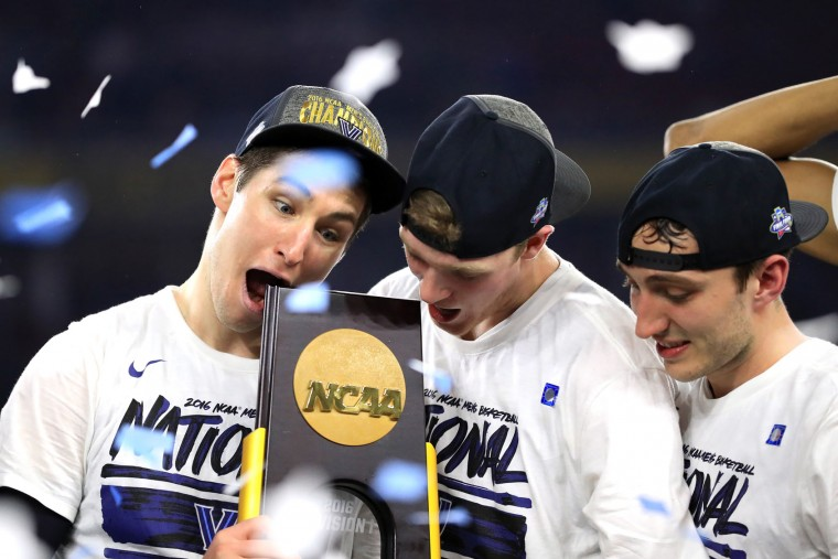 Ryan Arcidiacono #15 of the Villanova Wildcats (L) celebrates with the trophy after defeating the North Carolina Tar Heels 77-74 to win the 2016 NCAA Men's Final Four National Championship game at NRG Stadium on April 4, 2016 in Houston, Texas. (Photo by Ronald Martinez/Getty Images)