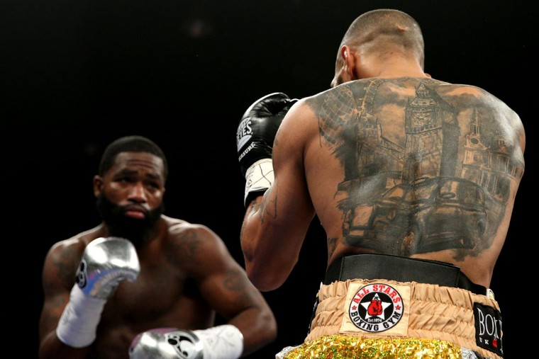 WASHINGTON, DC - APRIL 01: Ashley Theophane (R) and Adrien Broner exchange punches in their super lightweight championship bout at the DC Armory on April 1, 2016 in Washington, DC. (Photo by Patrick Smith/Getty Images)