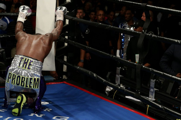 WASHINGTON, DC - APRIL 01: Adrien Broner has a moment to himself after defeating Ashley Theophane (not pictured) by TKO in ninth round in their super lightweight championship bout at the DC Armory on April 1, 2016 in Washington, DC. (Photo by Patrick Smith/Getty Images)