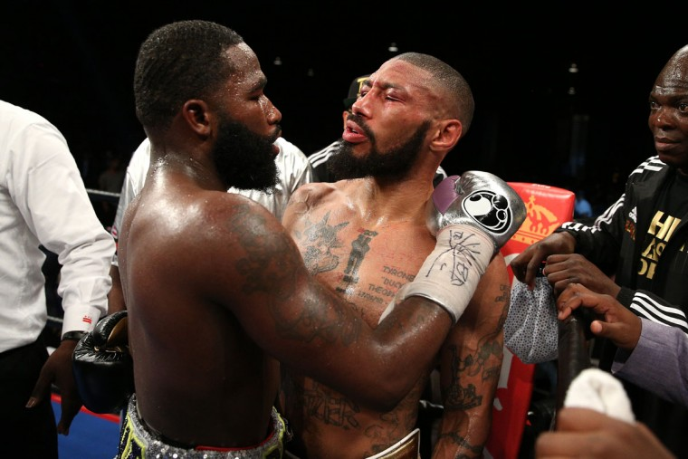 WASHINGTON, DC - APRIL 01: Adrien Broner (L) talks to Ashley Theophane after defeating him by TKO in ninth round in their super lightweight championship bout at the DC Armory on April 1, 2016 in Washington, DC. (Photo by Patrick Smith/Getty Images)