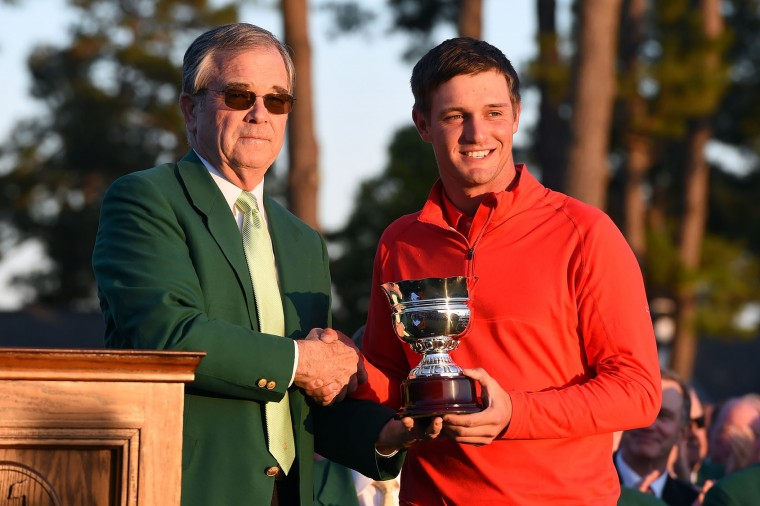 Amateur Bryson DeChambeau of the United States celebrates with Chairman of Augusta National, William Porter Payne after finishing as the low amateur in the final round of the 2016 Masters Tournament at Augusta National Golf Club on April 10, 2016 in Augusta, Georgia. (Photo by Harry How/Getty Images)