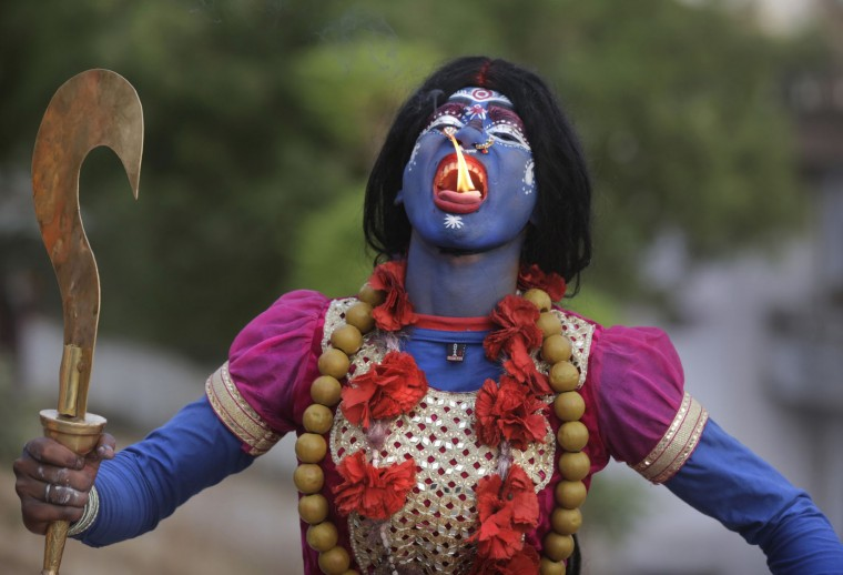 An Indian man dressed as Hindu Goddess Kali participates in a procession to celebrate the Ram Navami festival in Allahabad, India, Friday, April 15, 2016. Hindu devotees celebrate the festival of Ram Navami, the birth anniversary of Lord Rama, which also marks the end of the nine-day long fasting and Navaratri festival. (AP Photo/Rajesh Kumar Singh)