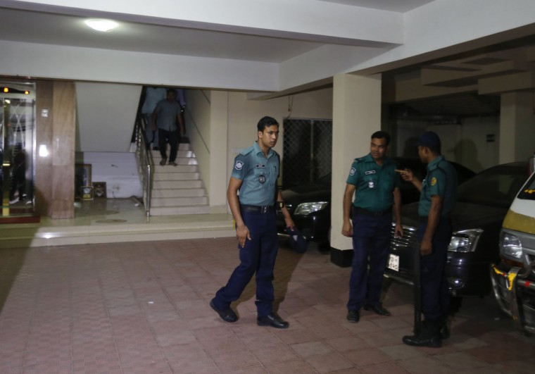 Bangladeshi policemen arrive at a building where two people were found stabbed to death in Dhaka, Bangladesh, Monday, April 25, 2016. Police in Bangladesh say unidentified assailants have stabbed two men to death, including a gay rights activist who also worked for the U.S. Agency for International Development. (AP Photo/A.M.Ahad)