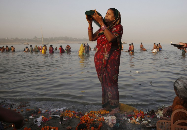 An Indian Hindu devotee performs morning rituals on the banks of the Ganges River on the first day of the nine-day Hindu festival of Navratri, in Allahabad, India, Friday, April 8, 2016. Navaratri lasts for nine days, with three days each devoted to the worship of the goddess of valor Durga, the goddess of wealth Lakshmi, and the goddess of knowledge Saraswati. (AP Photo/Rajesh Kumar Singh)