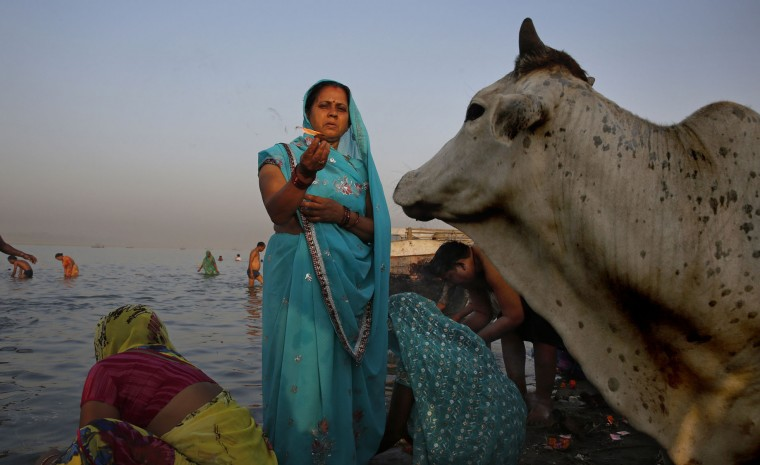 An Indian Hindu devotee holds an earthen lamp as she performs morning rituals on the banks of the Ganges River on the first day of the nine-day Hindu festival of Navratri, in Allahabad, India, Friday, April 8, 2016. Navaratri lasts for nine days, with three days each devoted to the worship of the goddess of valor Durga, the goddess of wealth Lakshmi, and the goddess of knowledge Saraswati. (AP Photo/Rajesh Kumar Singh)
