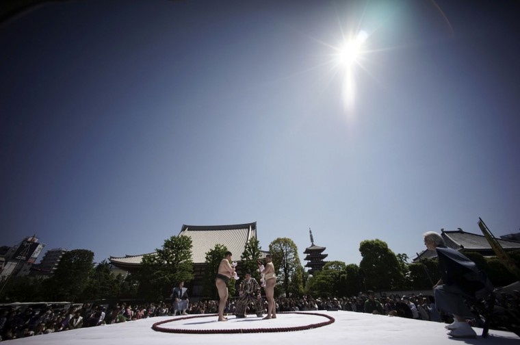Held by college sumo wrestlers, a couple of babies cry in their Naki Sumo or Crying Baby Contest at Sensoji Buddhist temple in Tokyo, Friday, April 29, 2016. The babies participated in the annual traditional ritual performed as a prayer for healthy growth of them. (AP Photo/Eugene Hoshiko)
