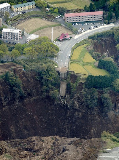 A bridge is cut off by landslides after the earthquake in Minamiaso, Kumamoto prefecture, Japan, Saturday, April 16, 2016. The village near Mount Aso volcano appears to have been the hardest hit by the second earthquake. Army troops and other rescuers rushed Saturday to try to reach scores of trapped residents after a pair of strong earthquakes in southwestern Japan. (Kyodo News via AP)
