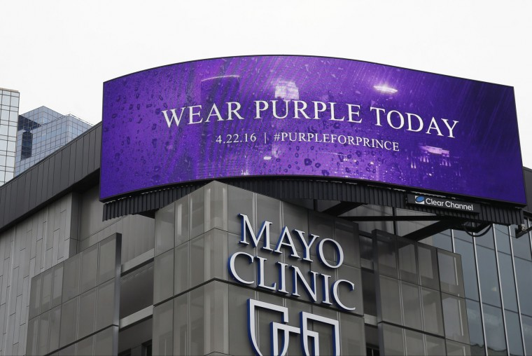 "A sign above the Mayo Clinic, Friday, April 22, 2016, in Minneapolis asks people to wear purple in memory of the pop super star Prince who died Thursday at the age of 57. Prince's ""Purple Rain"" was considered one of his best albums. (AP Photo/Jim Mone)"