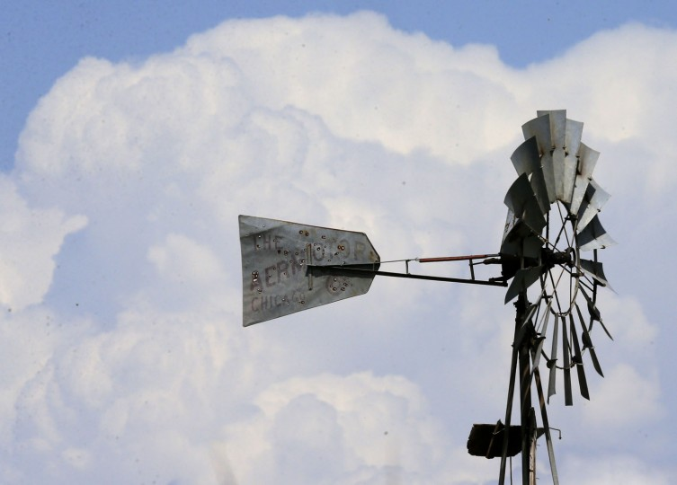 Storm clouds build up behind a windmill near Ellsworth, Kan., Tuesday, April 26, 2016. The plains are bracing for a possible severe weather outbreak. (AP Photo/Orlin Wagner)