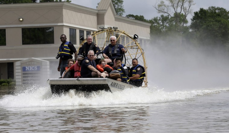 Residents are evacuated by airboat from their flooded neighborhood, Tuesday, April 19, 2016, in Spring, Texas. Storms have dumped more than a foot of rain in the Houston area, flooding dozens of neighborhoods. (AP Photo/David J. Phillip)