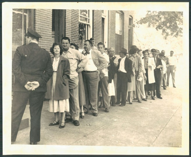 Lining up to vote on Ensor Street. 9th Ward. 1950
