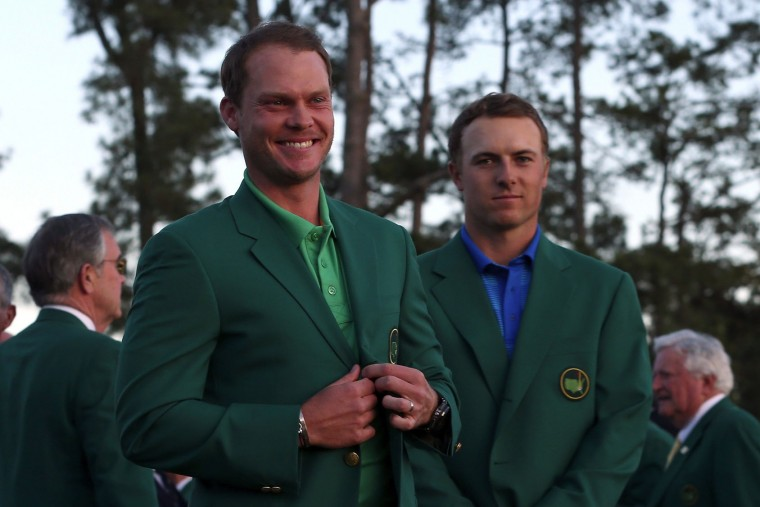 Jordan Spieth of the United States presents Danny Willett of England with the green jacket after Willett won the final round of the 2016 Masters Tournament at Augusta National Golf Club on April 10, 2016 in Augusta, Georgia. (Photo by Andrew Redington/Getty Images)