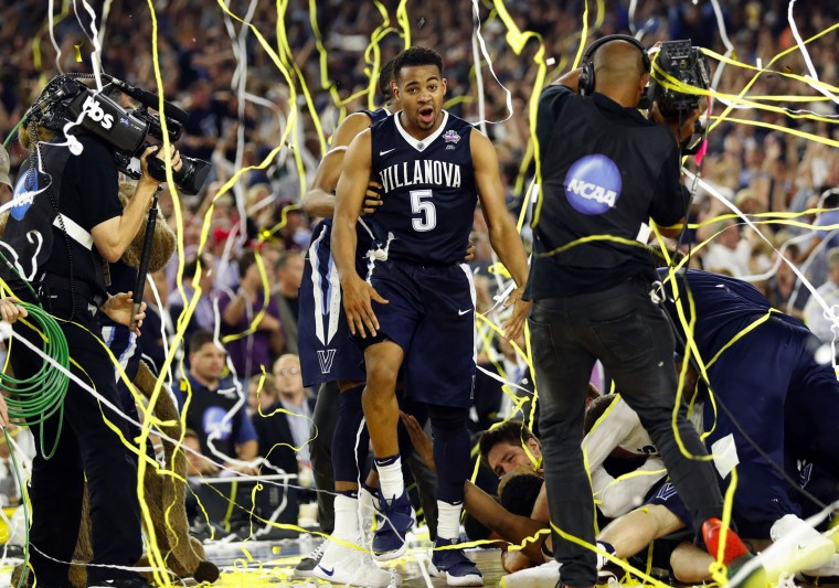 Villanova's Phil Booth (5) celebrates after the NCAA Final Four tournament college basketball championship game against North Carolina, Monday, April 4, 2016, in Houston. Villanova won 77-74. (AP Photo/Eric Gay)