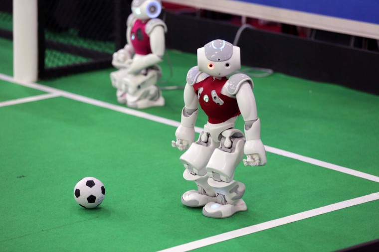 A robot from Iran's Qazvin Islamic Azad University takes part in a soccer match against German Nao-Team HTWK from the Leipzig United University during the RoboCup Iran Open 2016, in Tehran, on April 6, 2016. (ATTA KENARE/AFP/Getty Images)