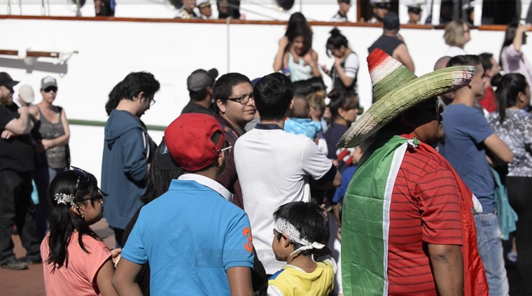 Rogelio Billa from Guadalajara, Mexico, pictured at right in sombrero, brought his children to watch the ship's arrival. Although he and his wife are both originally from Mexico, their children have never seen the country.(Christina Tkacik/Baltimore Sun)