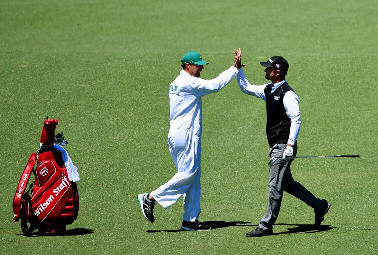 Kevin Streelman, right, high-fives caddie, A.J. Montecinos after making eagle on the 2nd hole during the third round of the 80th Masters at the Augusta National Golf Club in Augusta, Ga., on Saturday, April 9, 2016. (Jeff Siner/Charlotte Observer/TNS)