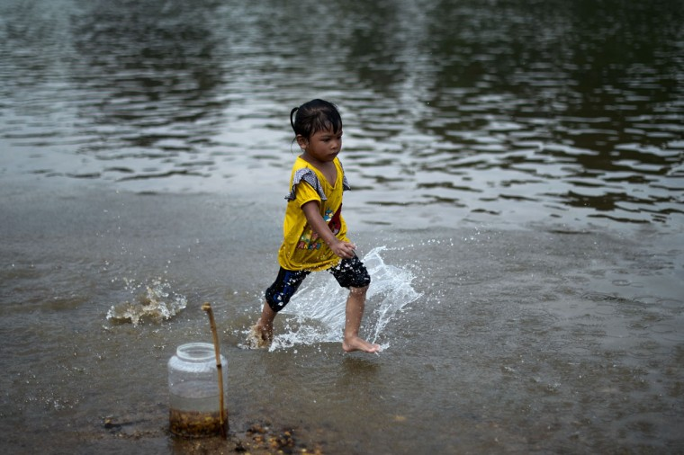 A child plays in a river to cool off as schools remain closed due to the ongoing heatwave in Termerloh, outside Kuala Lumpur, on April 11, 2016. (MOHD RASFAN/AFP/Getty Images)