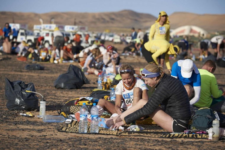 Competitors get ready prior to the second stage of the 31st edition of the Marathon des Sables on April 11, 2016 in the southern Moroccan Sahara desert. (JEAN-PHILIPPE KSIAZEK/AFP/Getty Images)