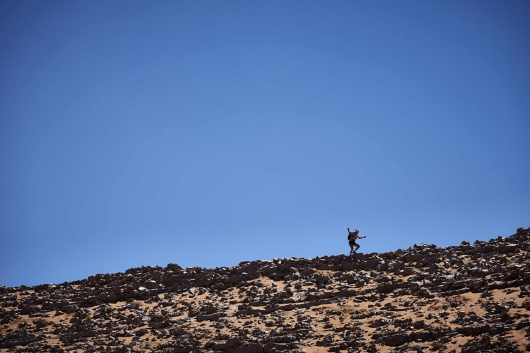 A competitor takes part in Stage 3 of the 31st edition of the Marathon des Sables between Oued Moungarf and Ba Hallou in the southern Moroccan Sahara desert on April 12, 2016. (JEAN-PHILIPPE KSIAZEK/AFP/Getty Images)