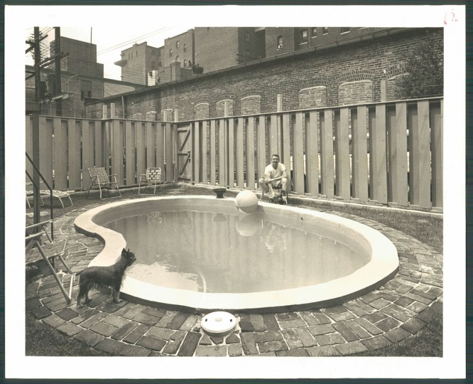 Private pool in Downtown Baltimore, August 22, 1965. Caption: Downtown Baltimore backyards can be nade attractive. Private effort by apartment house owner in the 100 block of S. Preston street features this relaxing swim pool.