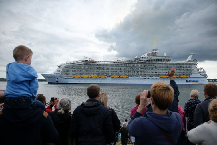 People watch from the shore as the Harmony of the Seas cruise ship sets sail from Southampton, southern England, on May 22, 2016. (ADRIAN DENNIS/AFP/Getty Images)