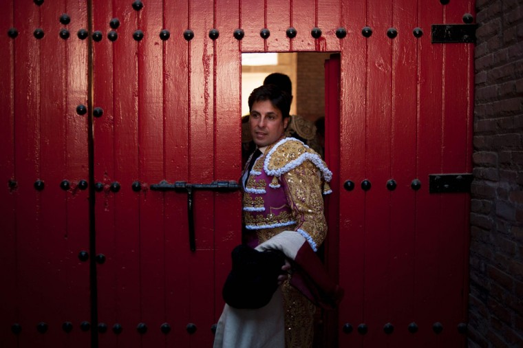 "Spanish matador Francisco Rivera Ordonez crosses a door before a ""corrida"" (bullfight) during the Corpus bullfighting festival at the bullring of Granada on May 25, 2016. (JORGE GUERRERO/AFP/Getty Images)"