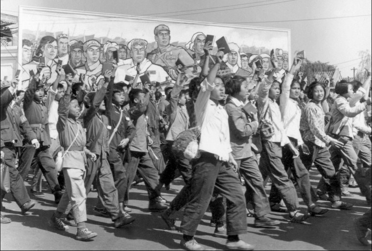 "This file photo taken in June 1966 shows Red Guards, high school and university students, waving copies of Chairman Mao Zedong's ""Little Red Book"" as they parade in Beijing's streets at the beginning of the ""Great Proletarian Cultural Revolution"". Launched by Mao in 1966 to topple his political enemies after the failure of the Great Leap Forward, the Cultural Revolution saw a decade of violence and destruction nationwide as party-led class conflict devolved into social chaos. (AFP PHOTO/ JEAN VINCENT)"