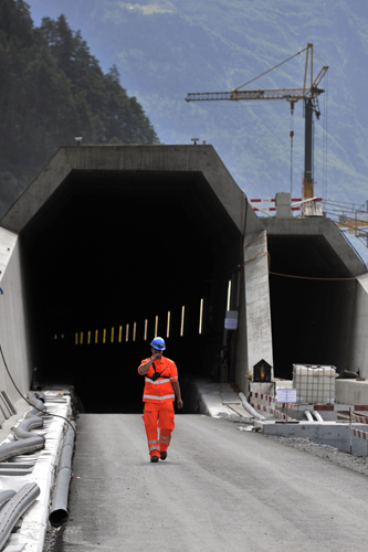 This file photo taken on September 2, 2011, shows a worker exiting the Saint-Gothard base access tunnel during the launching of the installation of railway equipment in Erstfeld, central Switzerland.(FABRICE COFFRINI/AFP/Getty Images)