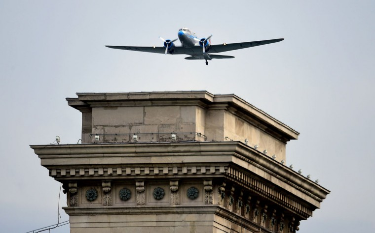 A Russian made Li-2 air plane flies over the oldest Hungarian bridge, the 'Lanchid' (Chain Bridge) of Danube River in Budapest on May 1, 2016 during the Budapest Air Show. (ATTILA KISBENEDEK/AFP/Getty Images)