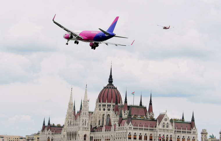 A Wizz Air Airbus A321 flies over the Danube River at the Hungarian parliament building in Budapest on May 1, 2016 during the Budapest Air Show. (ATTILA KISBENEDEK/AFP/Getty Images)