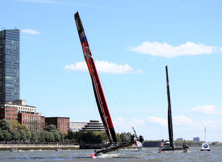 Emirates Team New Zeland and Oracle Team USA are in a tight race for the finish during Day 2 of the Louis Vuitton America's Cup World Series Racing on May 8, 2016 on the Hudson River in New York City. Emirates Team New Zealand won the series. (Photo by Elsa/Getty Images)