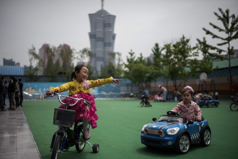 Children play at a day care centre for children of workers at a silk factory in Pyongyang on May 9, 2016. (AFP PHOTO / Ed Jones)