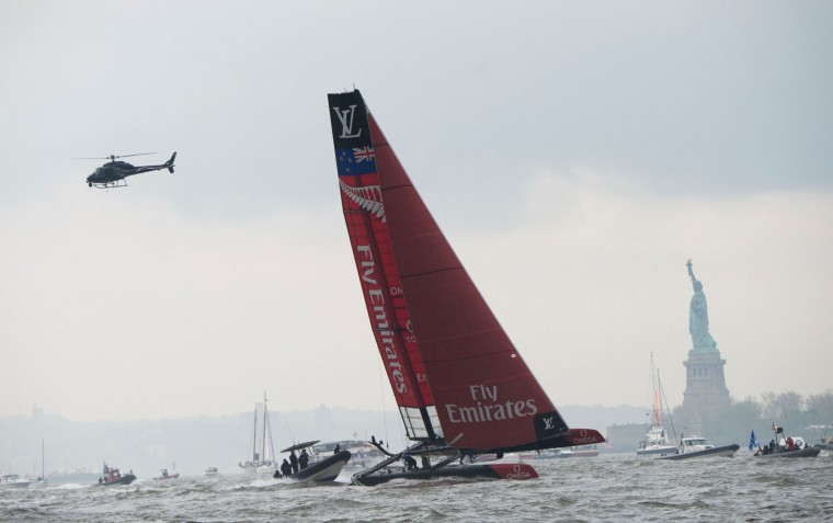 Emirates Team New Zealand sails past the Statue of Liberty during pre-racing in the Louis Vuitton America's Cup World Series New York May 7, 2016 in New York. (Don Emmert/AFP/Getty Images)
